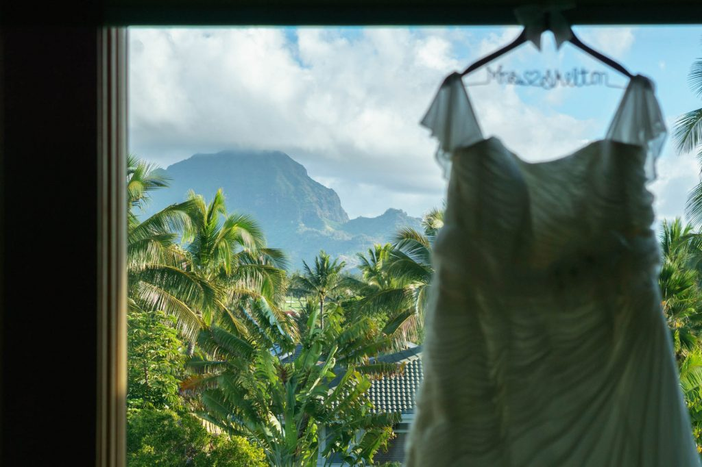Wedding dress with Kauai landscape in the background.
