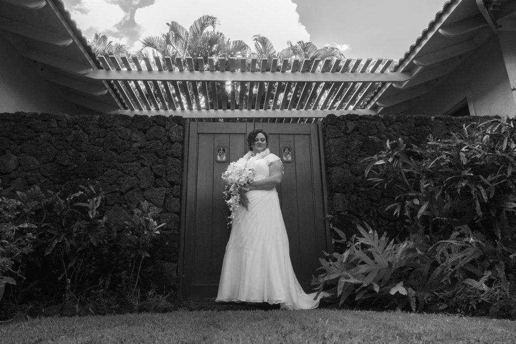 Bride posing in a garden.