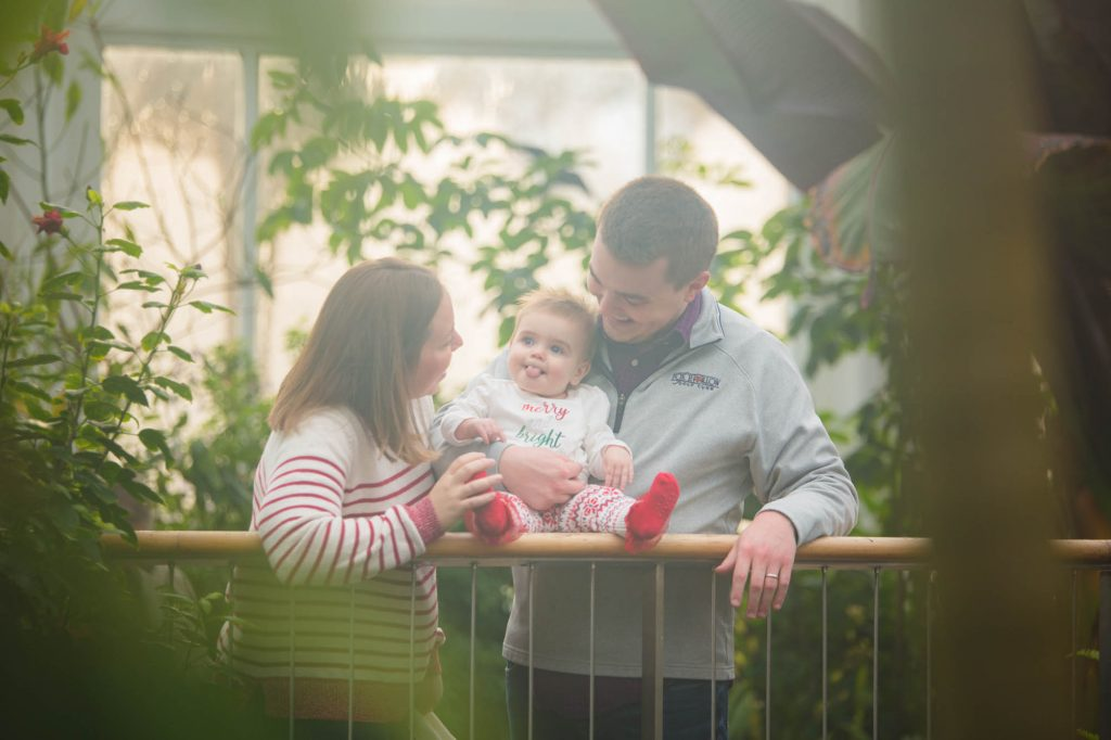 Family in a greenhouse.